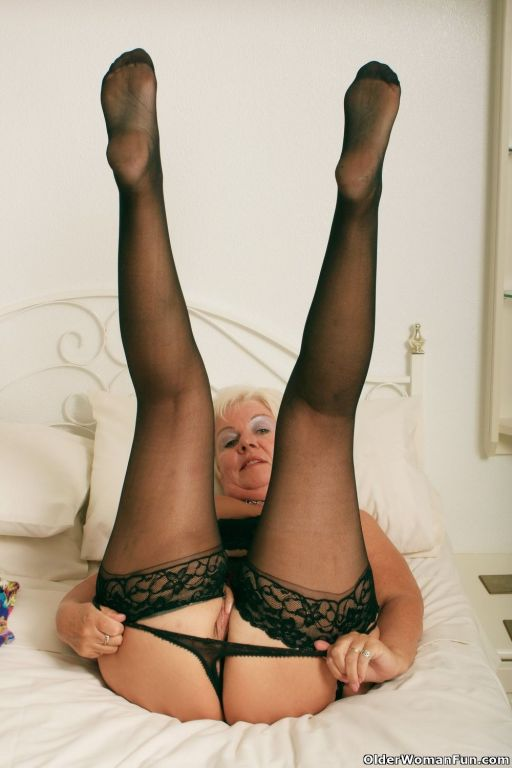 Chubby grandma Sandie in black stockings