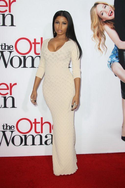 Nicki Minaj busty showing big cleavage in a tight