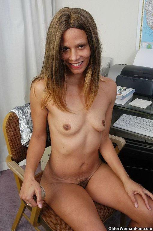 Mature secretary Liz shows her hairy pussy
