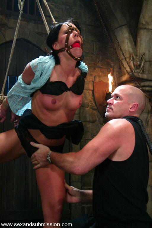 Submissive Julie Night endures bondage while she t