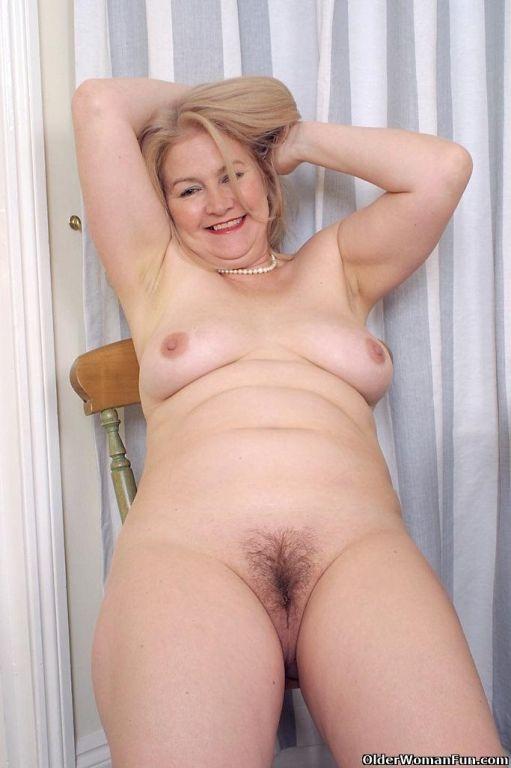 Grandma Danielle lowers her panties
