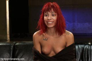 Slutty redhead gets gangbanged