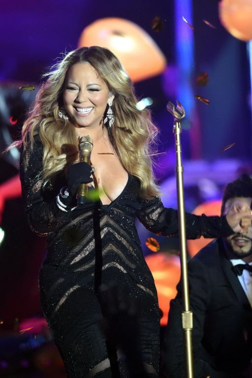 Mariah Carey cleavy wearing two skimpy dresses at