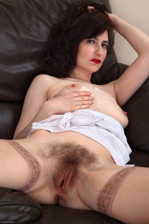 Hairy MILF Natasha shows off her stockings