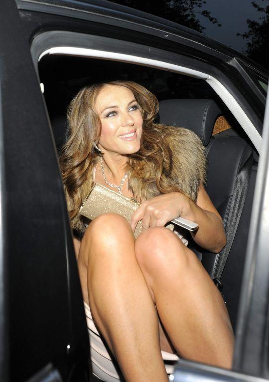 Elizabeth Hurley leggy  cleavy wearing a mini dres