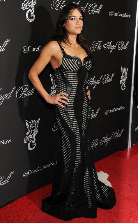 Michelle Rodriguez cleavy wearing a monchrome dres