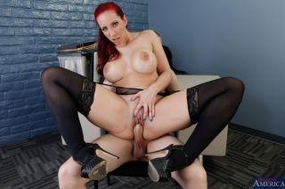 Redhead teacher Kelly Divine rides cock on a table