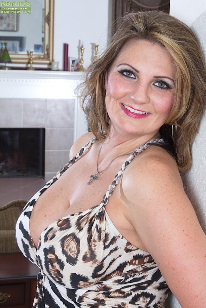 Horny big tit mature