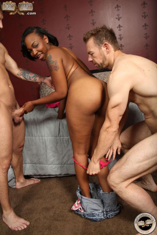 Ebony whore rides two dicks and takes nasty facial