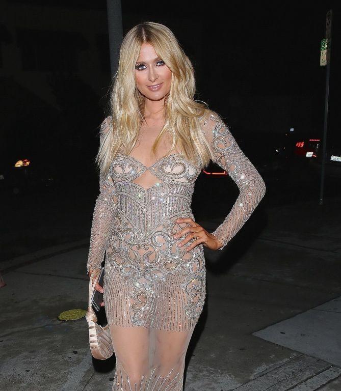 Paris Hilton wears only tiny panties under a trans