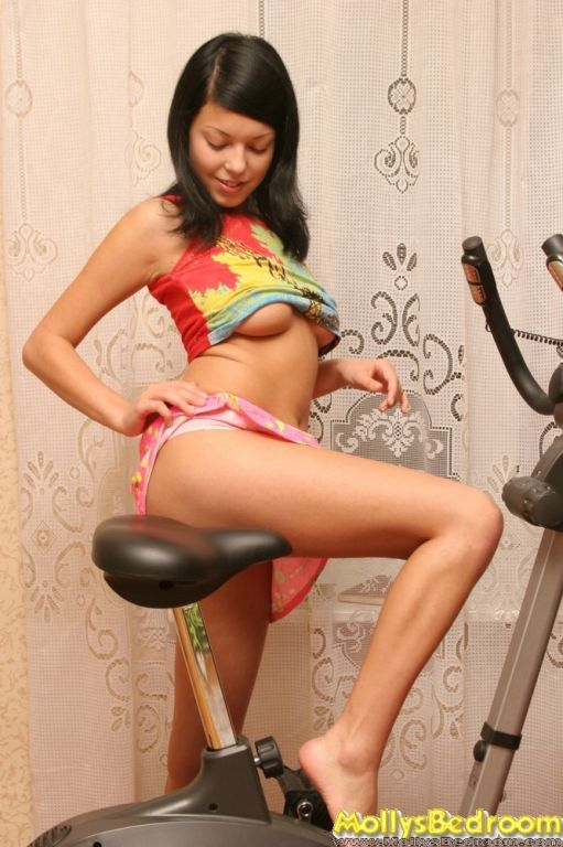 Hot Molly gets hot and naked on her exercising bic