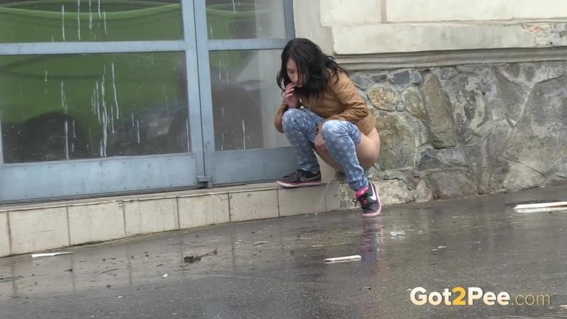 girl pisses in public