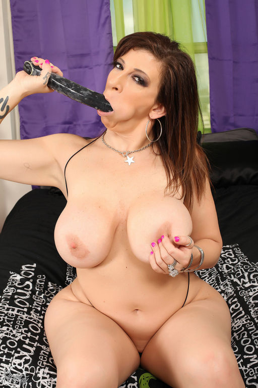 Sexy Sara Jay Plays with Her Big Black Dildo