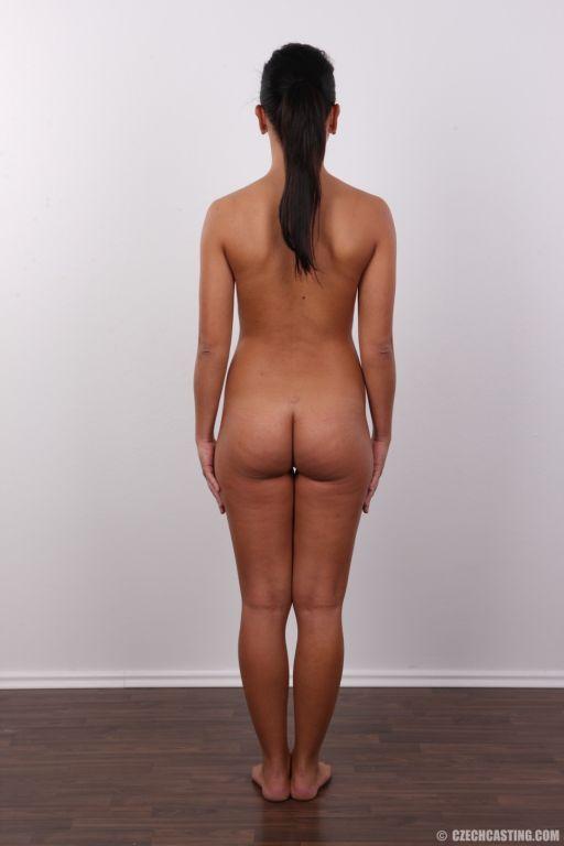 Sweet brunette shows of her naked body