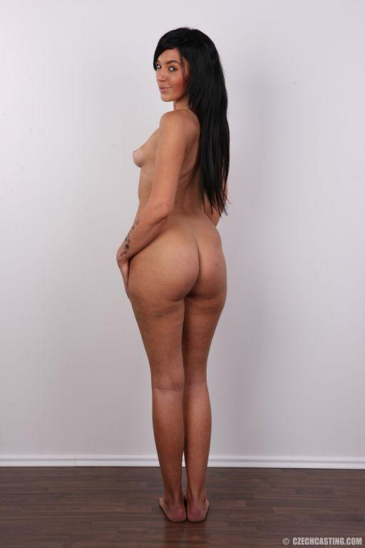 Gorgeous brunette gets naked