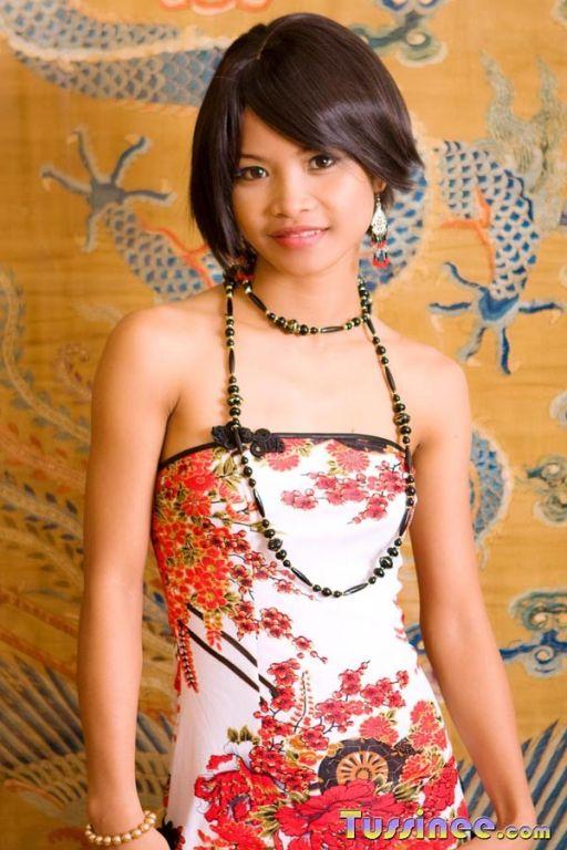 Beautiful Tussinee dressed like a China doll strip