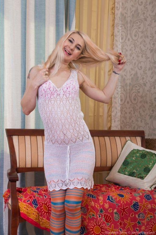 Elizabeth Johns shows off striped tights