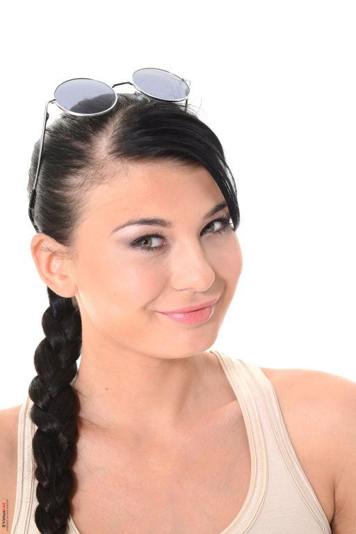 Sweet brunette teen Lucy poses like a Lara Croft