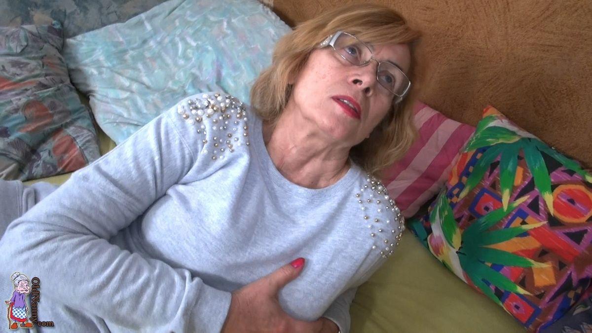 Granny Masturbating On Dildo