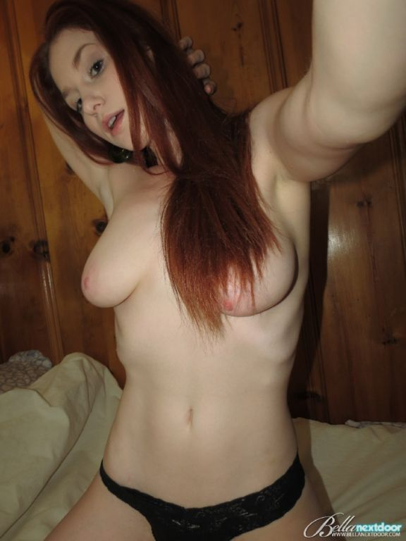 Busty red hot amateur naked in bed