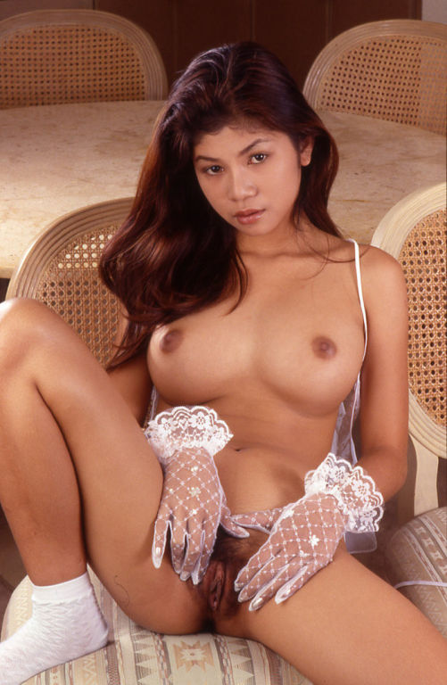Thai bar girl in white lingerie undressing