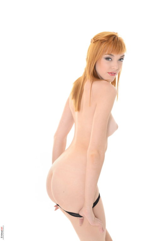 Teen redhead beauty takes off her sexy black dress