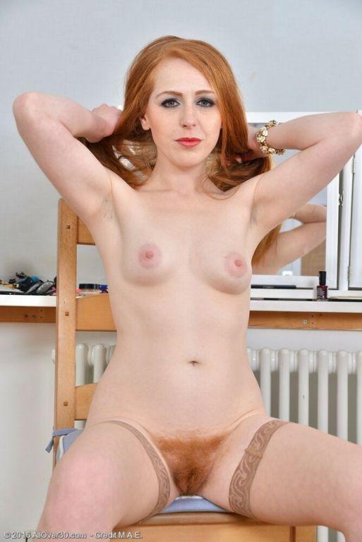 Tia Jones redhead in tan stockings shows hairy pus