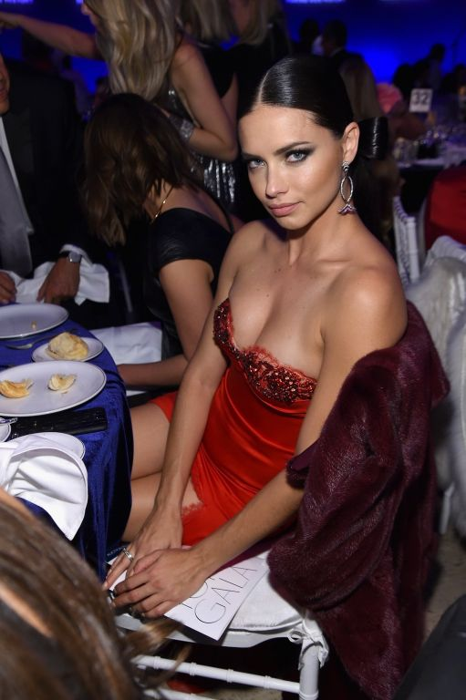Adriana Lima busty and leggy in a strapless orange