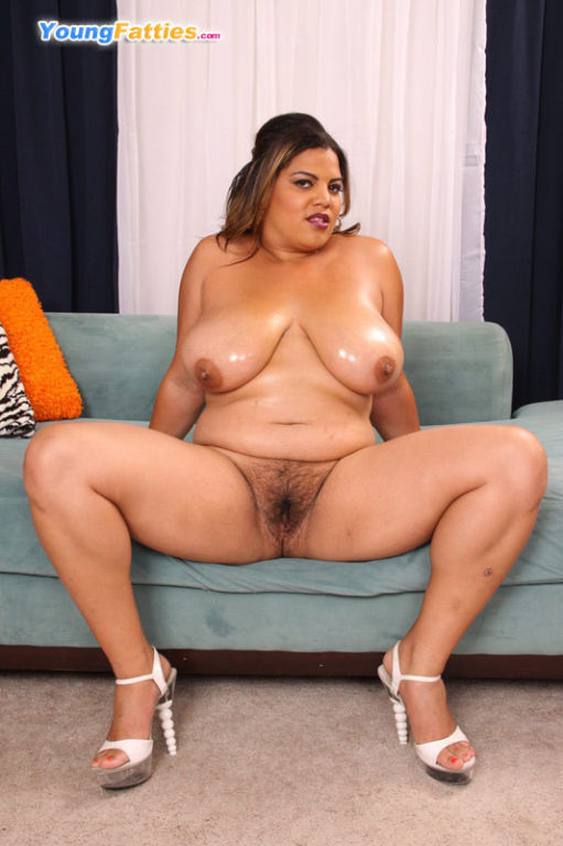 Hot fresh fatty spreads hips to show hairy slit