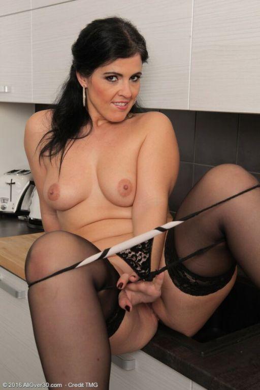 Montse Swinger sexy brunette in stockings plays fr