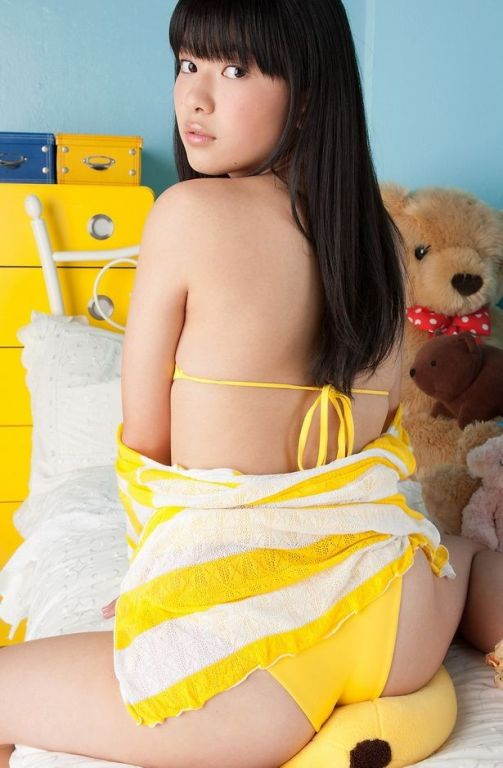 Pretty asian model Tomoe Yamanaka posing in bikini