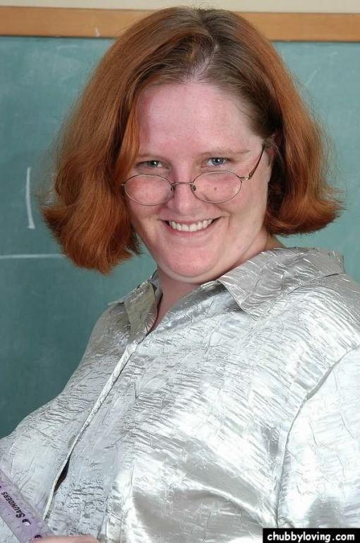 Fat redhead teacher Adrienne Plump teasing in clas