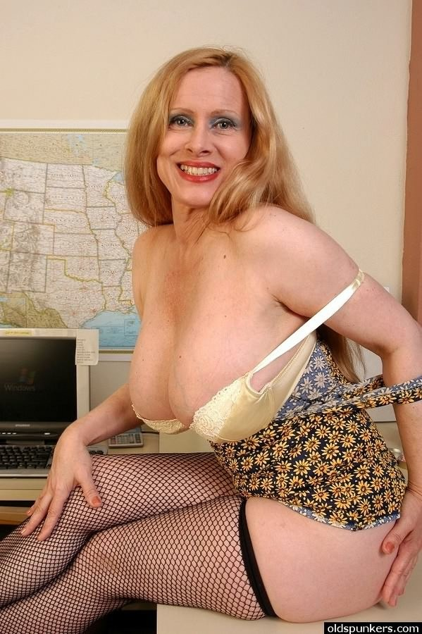 Busty mature plumper in stockings teases and spreads pussy ...