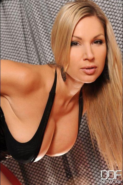 Carol Goldnerova busty blonde in black latex and b