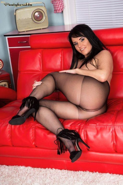 Beauty brunette showes her legs in black sheer pan