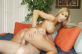 Busty cougar Morgan Ray rides a cock in sex action