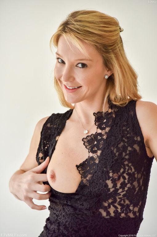Beautiful sexy blonde milf posing in sexy black dr