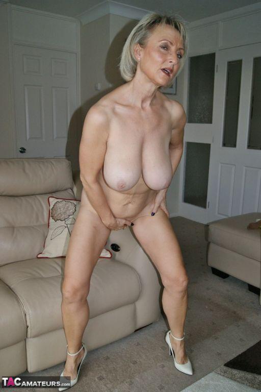 Big tits mature fingering shaved cunt