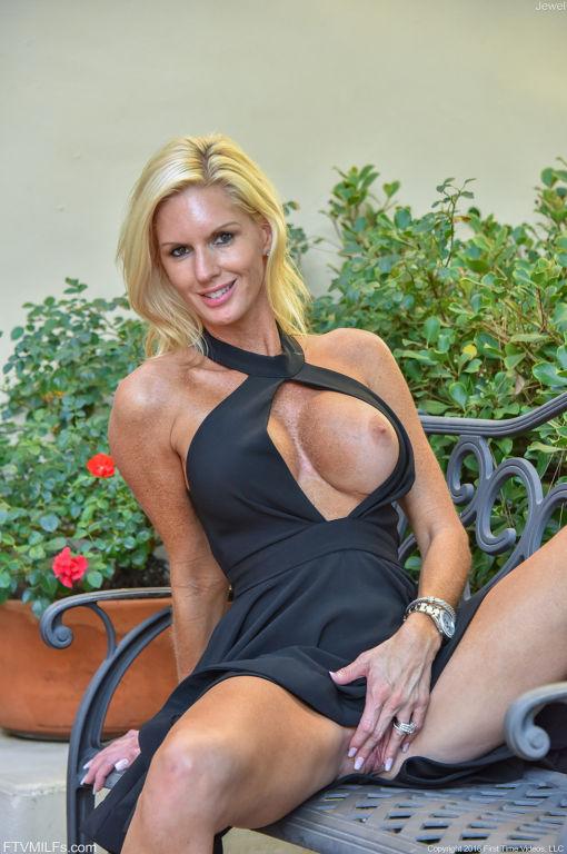 Amazing blonde big tit milf wearing sexy dress