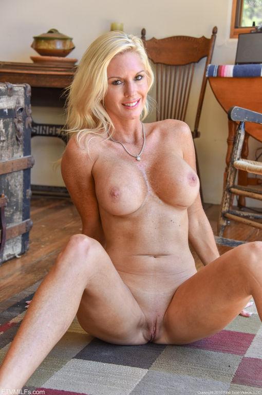 Blonde milf with big round boobs posing naked