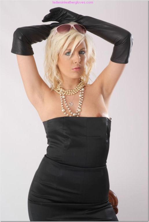 A very elegant blonde babe wearing a gorgeous blac
