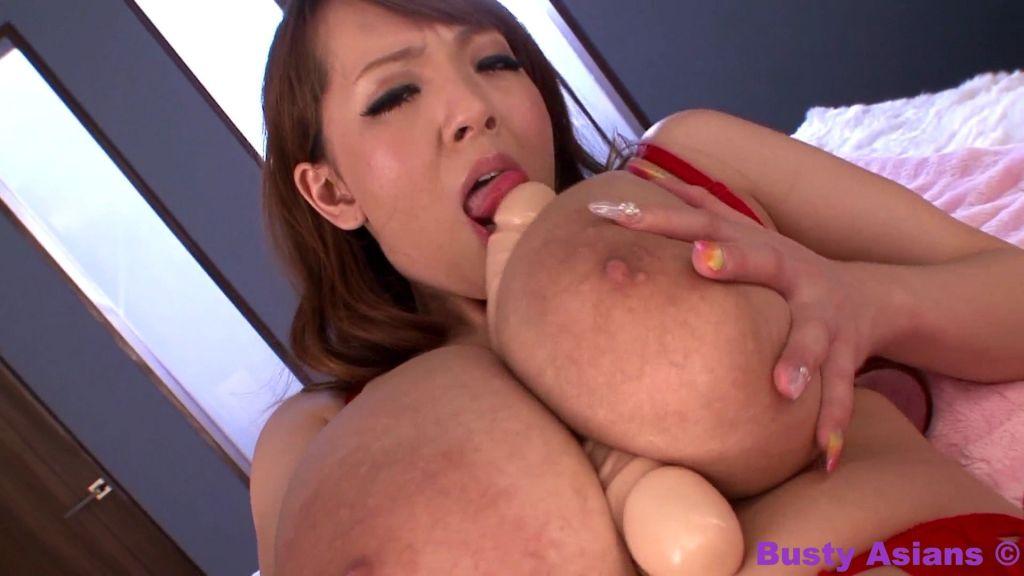 Hitomi Tanaka playing with a big dildo and her hug