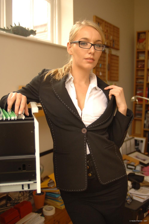 Hot blonde secretary spreading long legs in white stockings ...
