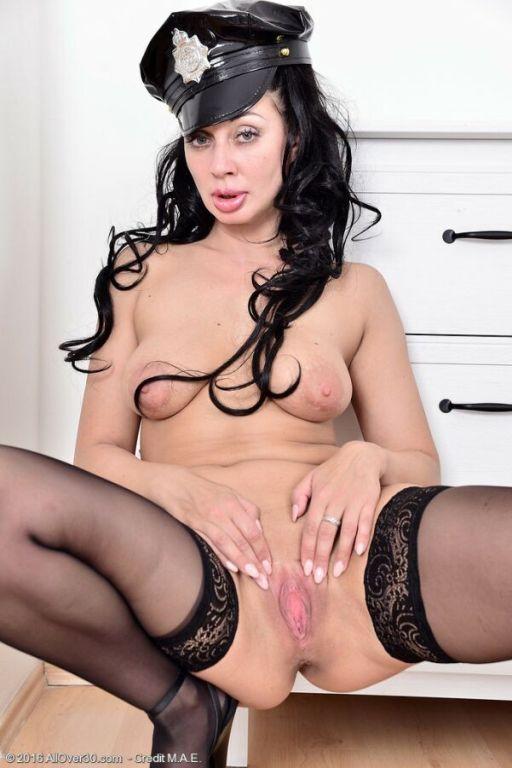 Eva Ann darkhaired milf cop in black stockings