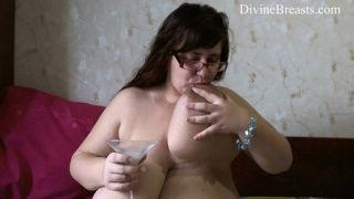 Lactating plump amateur milks her big tits into a