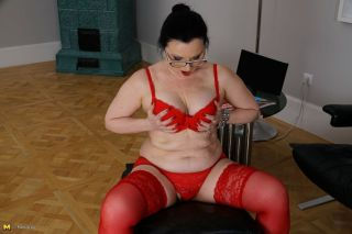 Horny mom in a dress and red stockings strips