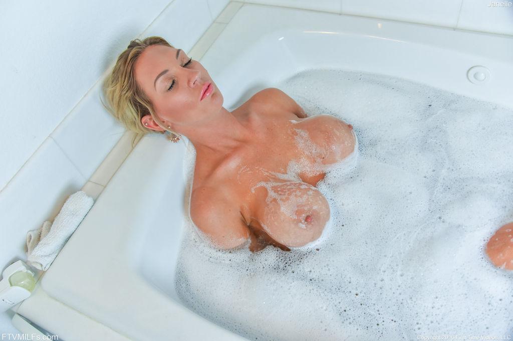 Blonde busty milf taking a hot bubbly bath