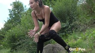 Outdoor pissing for hot babe in black denim