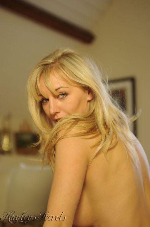 Long legged beauty blonde spreading in lingerie an