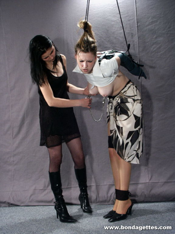 Lezdom Mistress uses a leather arm binder to secur